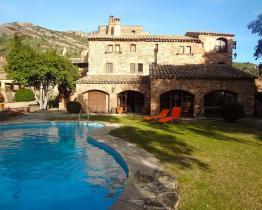 Indrukwekkende Masía landhuis met 8 slaapkamers in Sant Llorenç Savall