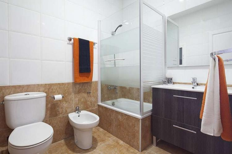 Full bathroom with bathtub and bidet.