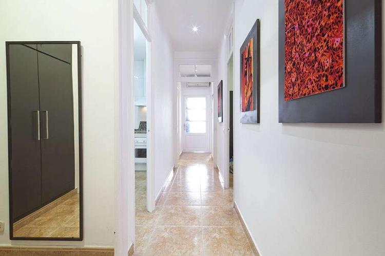 This long hallway with gorgeous tiled floors connect the rooms of this sophisticated apartment.
