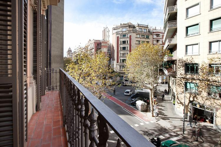 Splendid balcony with view to the famous Carrer de la Diputacio