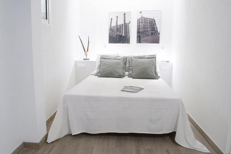 The white color in the beautiful bedroom gives a sense of  calmness and relax