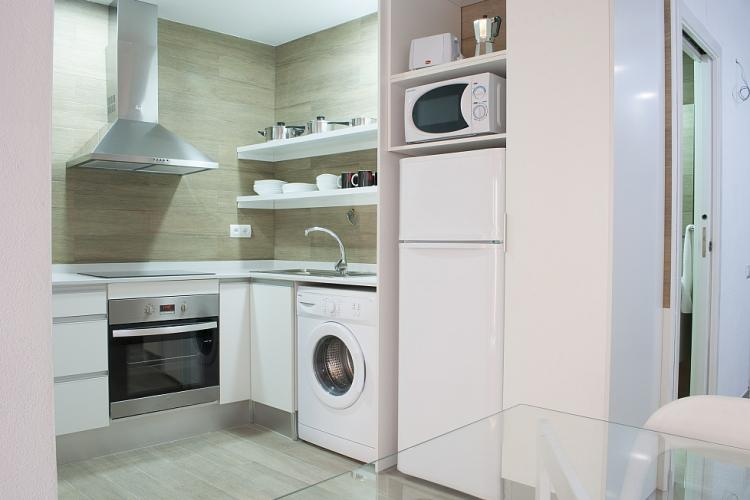 The modern kitchen is fully equipped with all utilities of the best quality