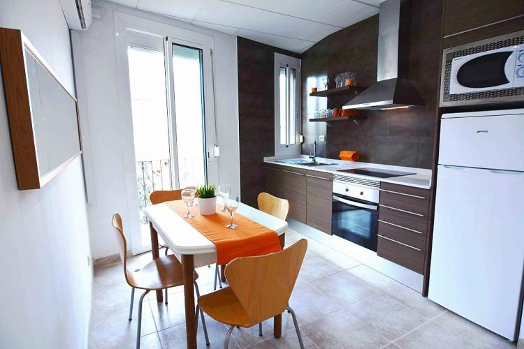 The modern kitchen with the dining area for 4 people.