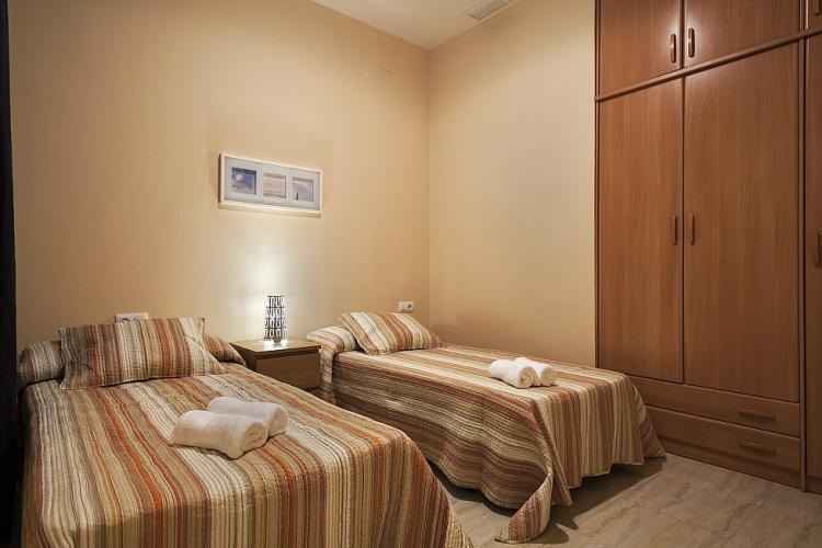 One of the bedrooms comes with two cozy single beds.
