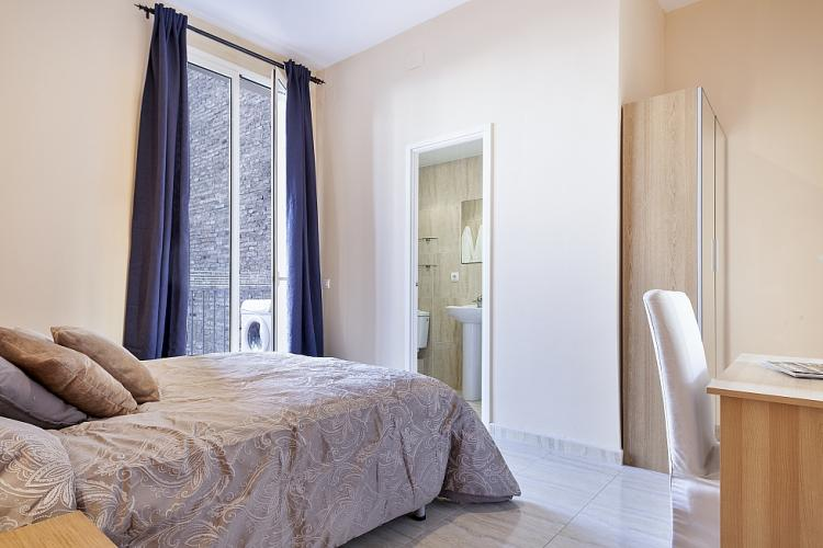 The bedroom features a comfortable double bed and plenty of natural light as well.