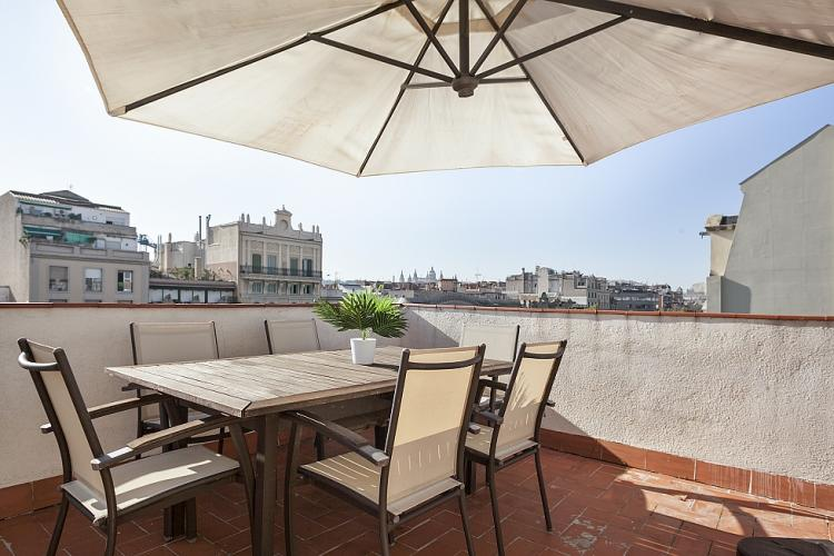 The terrace provides exceptional views over the rooftops of Barcelona.