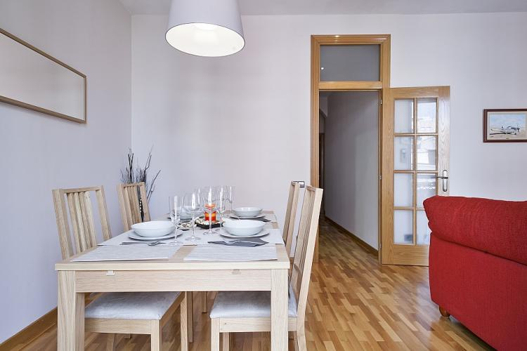 The living room integrates also dining space