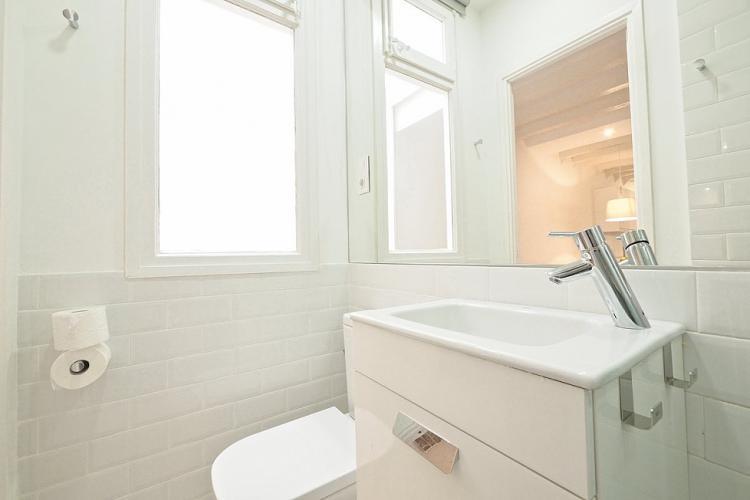 Bathroom with big mirror.