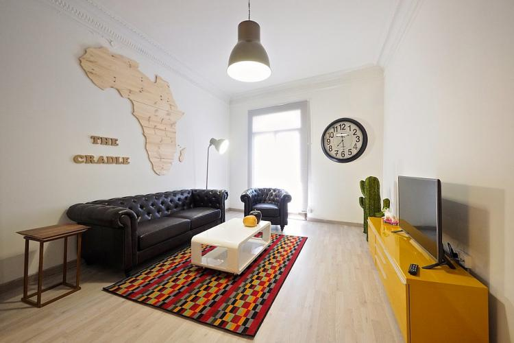 The living room features an eclectic design.