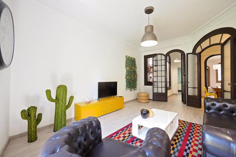 The living room features a nice combination of colors and textures.