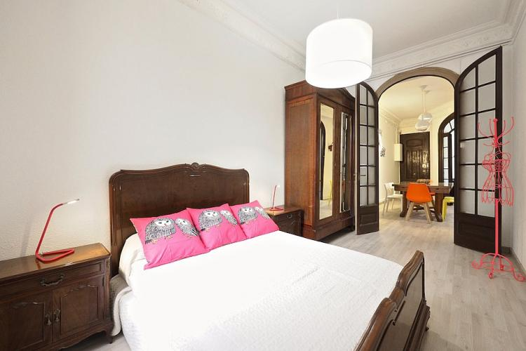 The bedroom has a classic design with modern touches,
