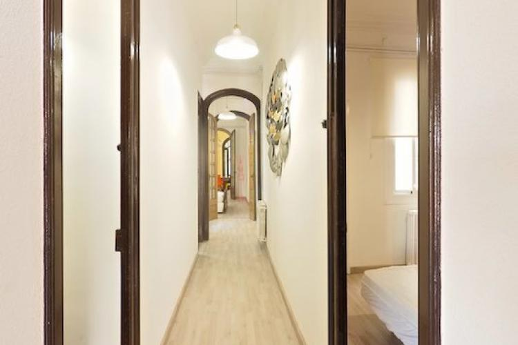 The hallway leads to other spacious bedrooms