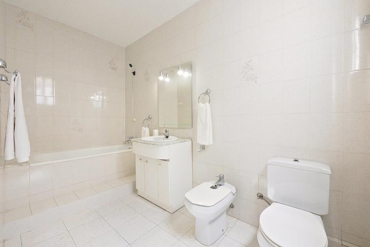 The bathroom comes bathed in light-beige tones