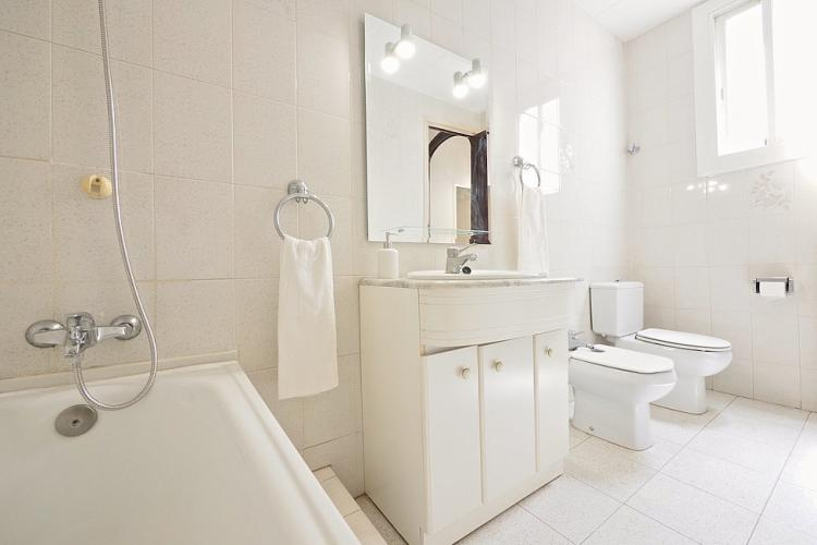 Bathroom with bath, sink, toilet and bidet