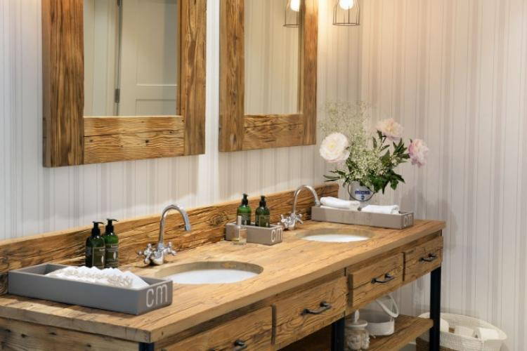 The sink cabinet is made from beautiful refurbished wood which lends a rustic feel to the place.