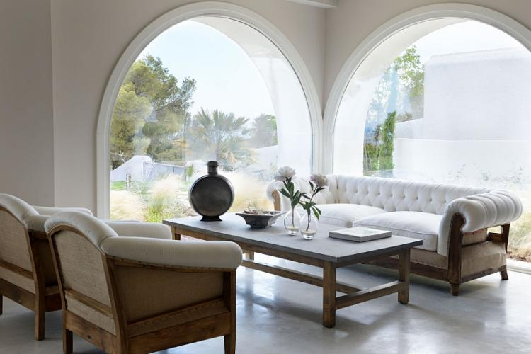 Large, elegant windows provide a beautiful view of the sea.