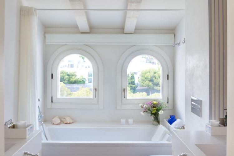 Bathrooms come with long tubs, perfect for a bubble bath after a day at the beach.