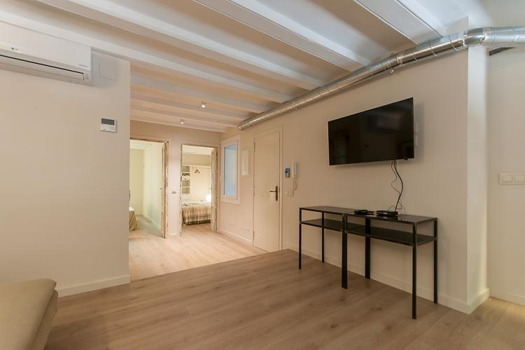 Smooth wooden flooring can be found throughout the apartment.