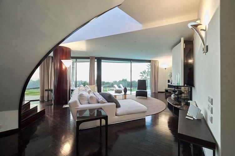 The villa is a stunning example of modern architecture, with interesting angles and curves to be found in each space.