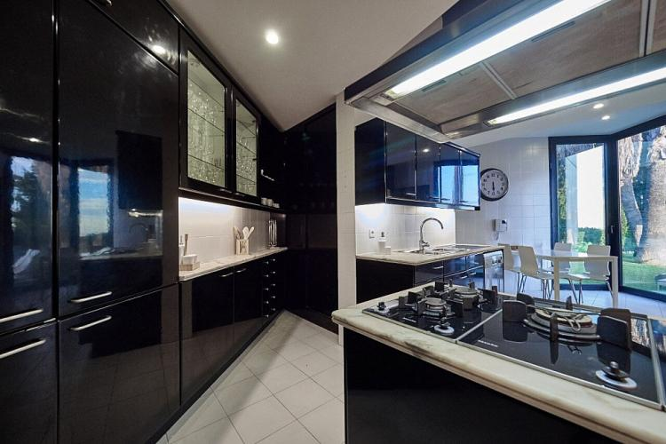 The angular layout of the kitchen and its vibrant black and white color scheme make it a truly dynamic space.