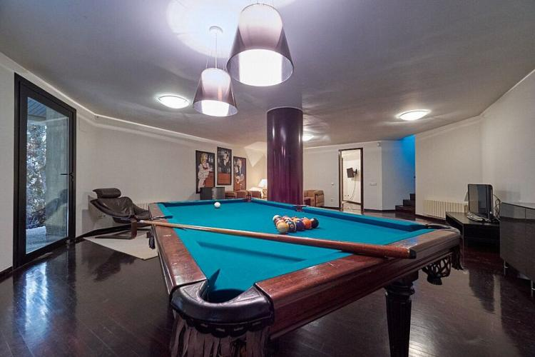 A pool table offers the perfect entertainment for a group of friends.