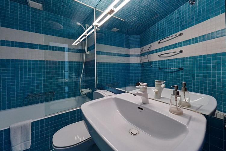 Modern and recently refurbished bathroom decked out in beautiful turquoise tiles.
