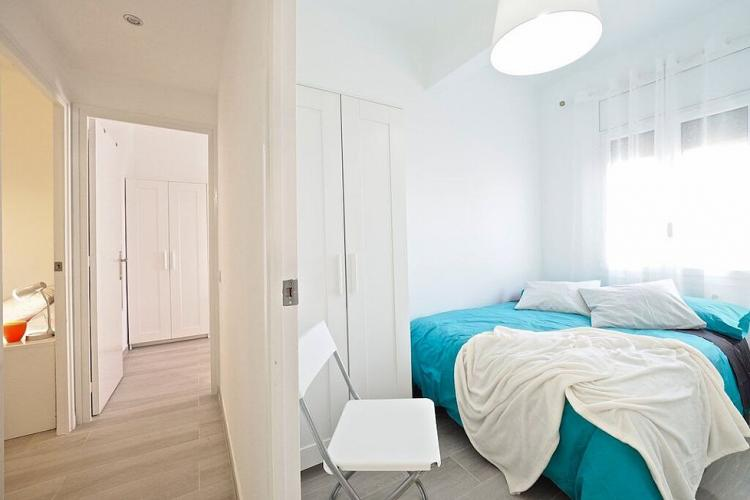 A hall from the first bedroom leads to the additional bedrooms.