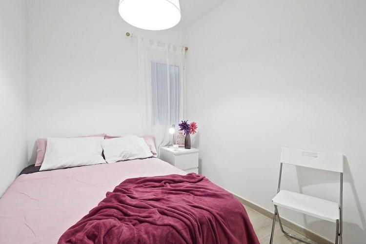 Another bedroom comes with fresh pink sheets and pink and white pillow cases.