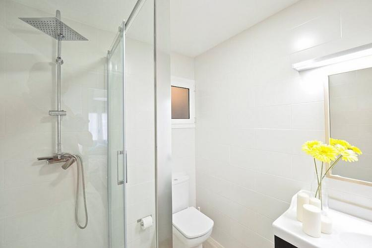 You will enjoy the modern waterfall shower head in this bathroom.