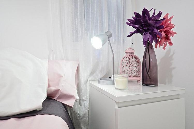 The nightstand is a great place for a reading lamp, candles or a pretty lantern.