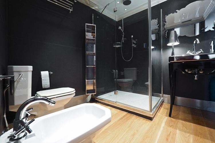 The black bathroom comes decorated with exquisite style featuring a black and silver color scheme.