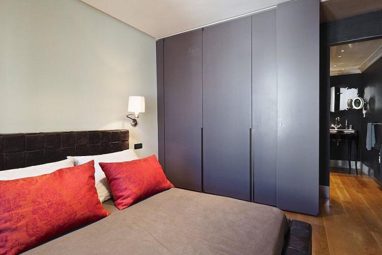A dark brown closet offers plenty of storage space.