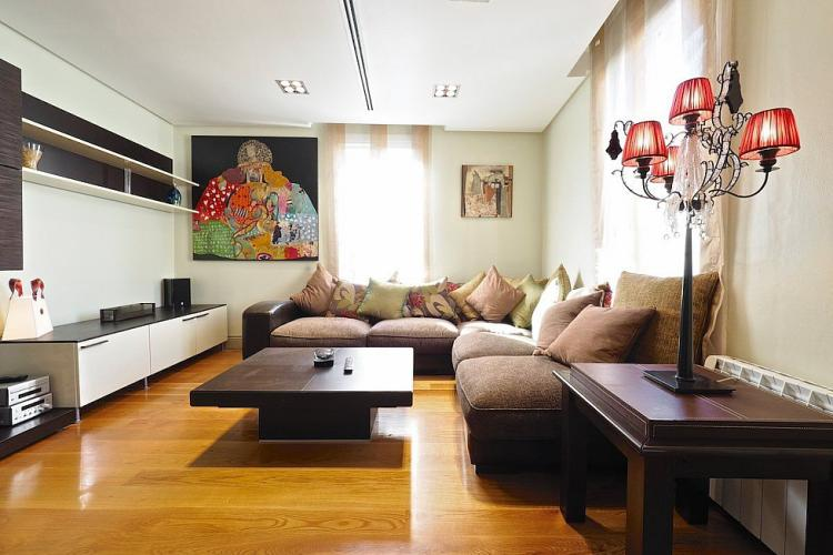 The living room comes with colorful and vibrant paintings on the walls.