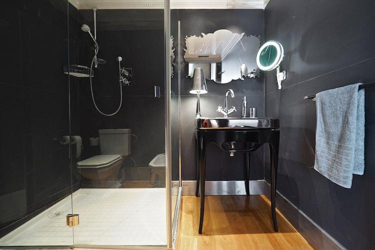 You will love the ample shower space in the black bathroom.