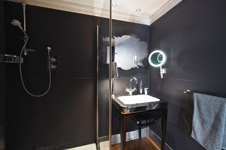 The black bathroom is the perfect place to get ready for a night out on the town.