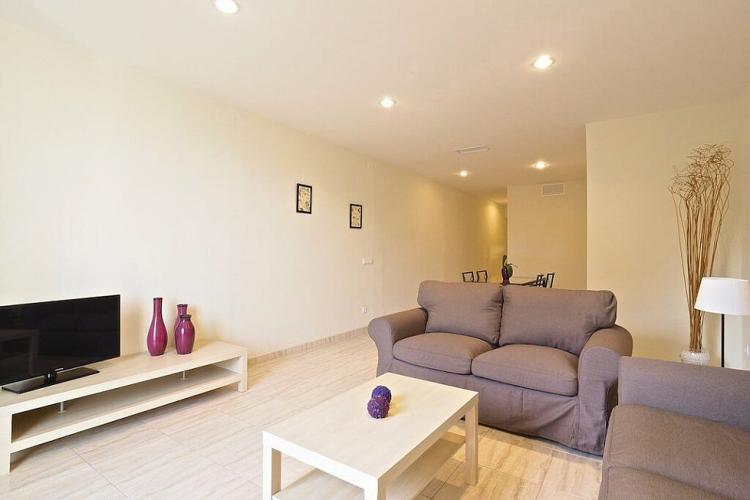 The apartment comes with LCD lighting, illuminating the space in a warm light at night.