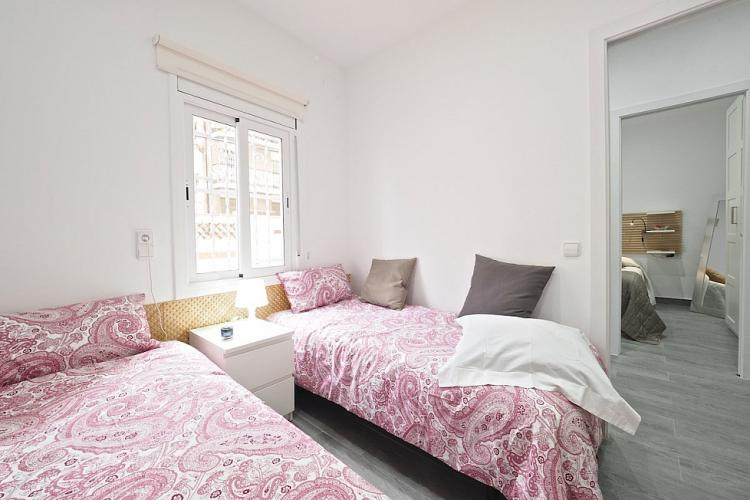 The bedroom with two single beds is perfect for two children or friends to share.