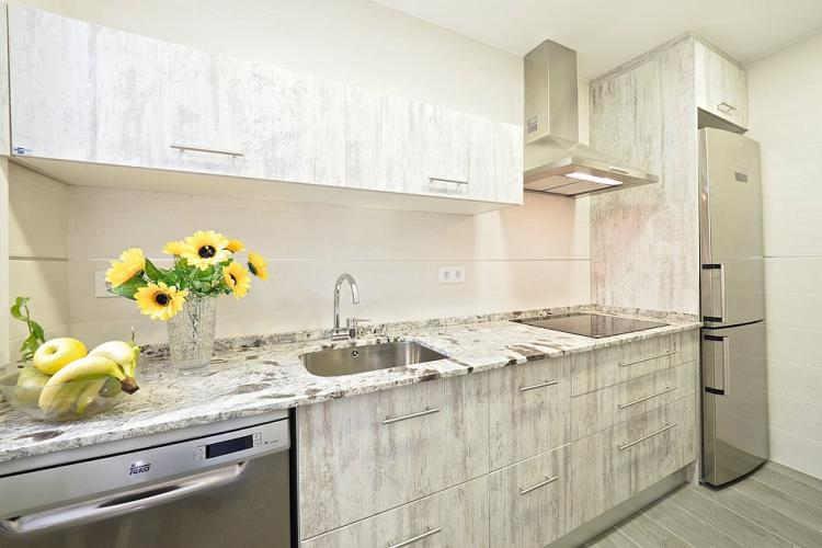 You will also have access to a beautiful kitchen featuring countertops and cabinets with a cool marble design.