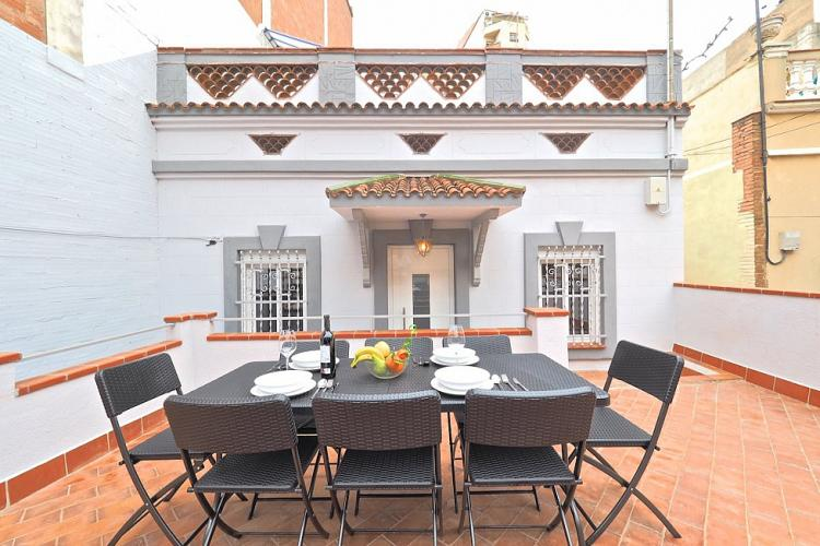 The facade of the building provides a great backdrop to the wonderful rooftop dining area.