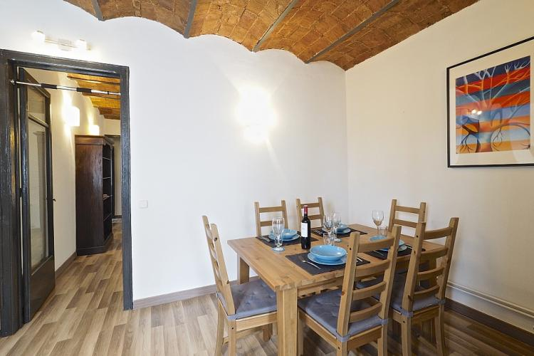 The dining area comes with a smooth wooden table for six.