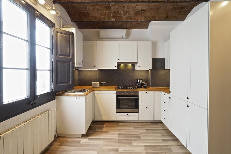 The kitchen is designed with a style reminiscent of the French countryside.