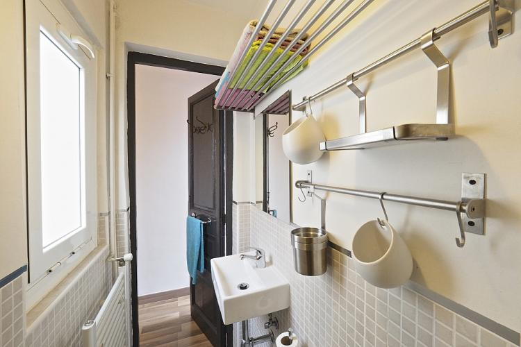 Iron bars across the wall provide plenty of space to hang your stuff.