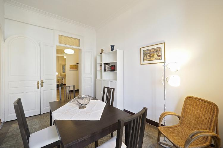 The dining area also comes with a cozy wicker chair to relax in for an addition person.