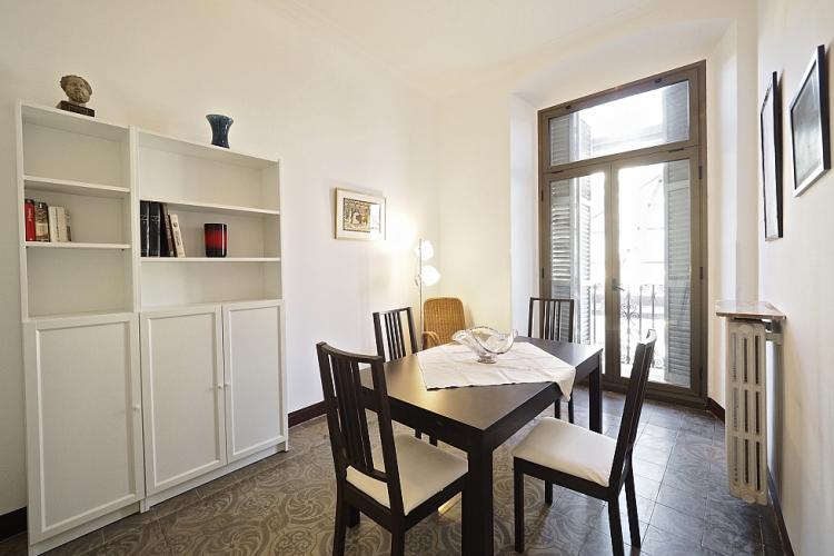 The apartment comes with a separate dining area with gorgeous mosaic tiles in yet another pattern on the floor.