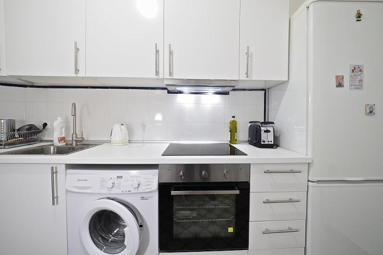 The kitchen is fully equipped with a stove, oven, refrigerator, freezer, toaster, water boiler, washing machine and sink.