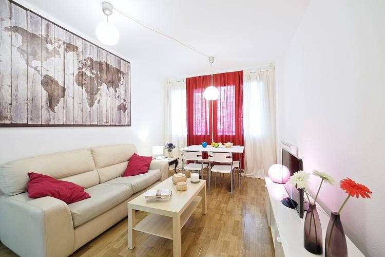 This apartment comes with gorgeous parquet floors and a simple, elegant decoration.