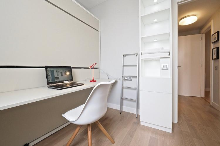 The space comes with long table that can become a bunk bed, scoop back chair and white board, perfect to get some work done during your trip.