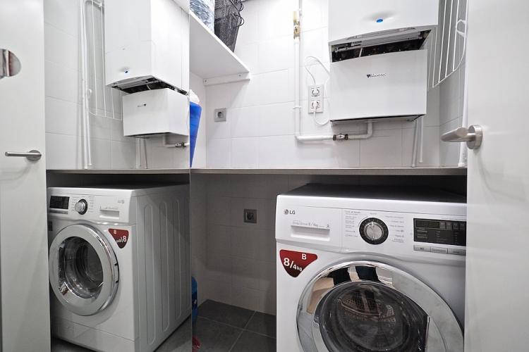 The apartment comes with a washer-dryer for your convenience.