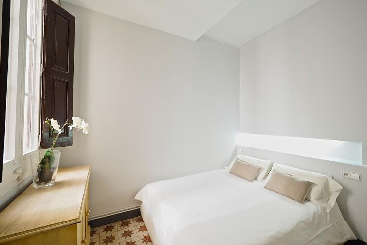 The master bedroom comes with a large and cozy double bed.