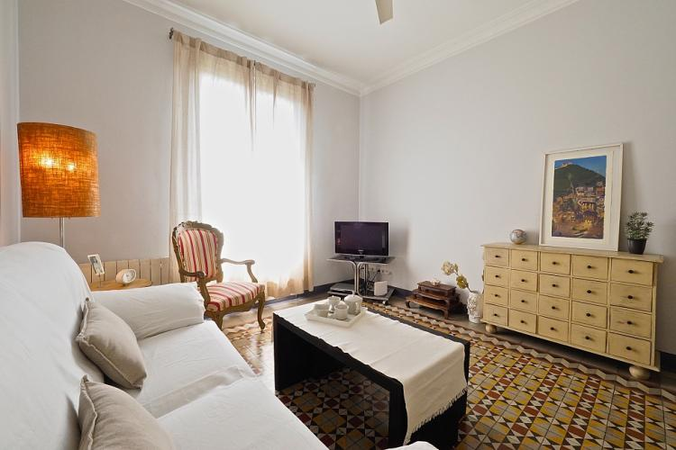 The living room features a great collection of antique furniture.